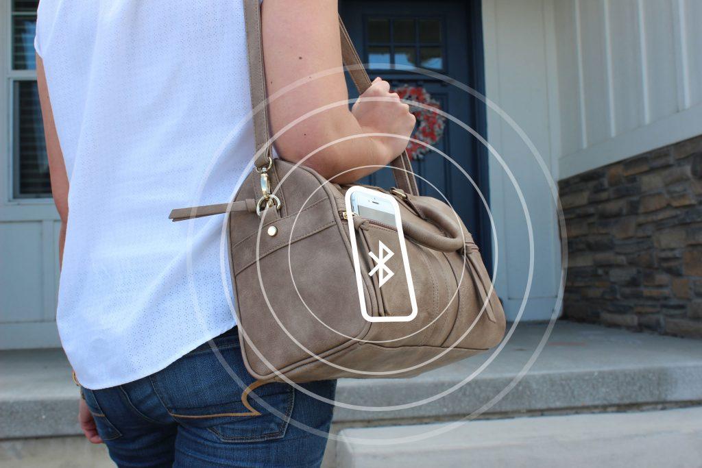En handväska med Bluetooth-symbol på I Säkra Larm